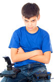 Boy sitting with joysticks Stock Photography