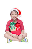 Boy sitting with many present boxes Royalty Free Stock Image
