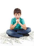 Boy sitting on money Stock Photography