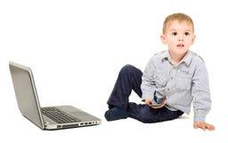 Boy sitting near laptop Royalty Free Stock Photo