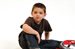 Boy sitting next to back pack Royalty Free Stock Image