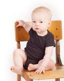 Boy sitting on old school chair Stock Image