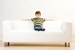 Free Boy Sitting On Couch Royalty Free Stock Image - 12412556