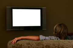 Free Boy Sitting On Couch Watching Widescreen Television Stock Images - 217084