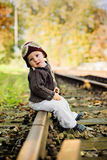 Boy, sitting outdoor Royalty Free Stock Photo