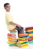 Boy sitting on a pile of books and learn Stock Photos