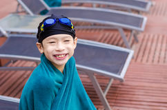Boy sitting beside the pool Royalty Free Stock Photography