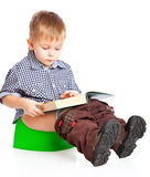 A boy sitting on the pot Stock Images