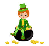 Boy sitting on a pot of gold at the Irish costume. Stock Photo