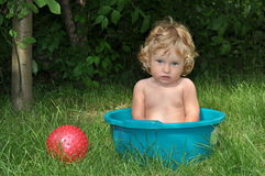 Boy sitting on a potty on the seashore Stock Images