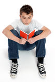 Boy sitting reading notebook Royalty Free Stock Photo