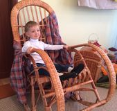 boy sitting on a rocking chair royalty free stock photos