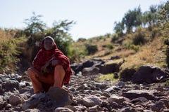 Boy sitting on rocks Royalty Free Stock Images