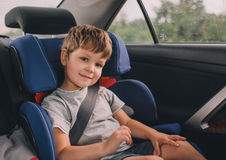 Boy sitting in safety car seat Royalty Free Stock Photography