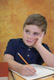 Boy Sitting School Desk Royalty Free Stock Images