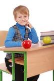 Boy sitting at a school desk Stock Photo