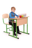Boy sitting at a school desk Stock Images