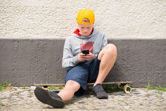 Boy Sitting On Skateboard Stock Photography