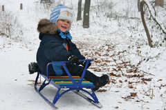 Boy sitting on a sledge Royalty Free Stock Images