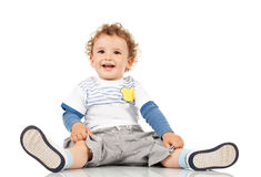 Boy sitting and smiling Royalty Free Stock Photos