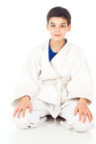 Boy sitting in the sports form Stock Photo