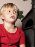 Boy sitting on stairs Royalty Free Stock Photo