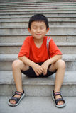 Boy Sitting on Stairs Royalty Free Stock Photos