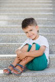 The boy sitting on the stairs in the underpass Royalty Free Stock Image