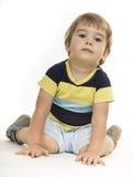 Boy sitting still Stock Photography