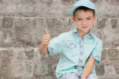 A boy is sitting on the stone steps Royalty Free Stock Photography