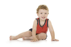 Boy sitting in the studio Stock Images