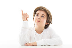 Boy sitting at table looking up Royalty Free Stock Photography