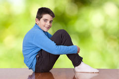 Boy sitting on the table Stock Image