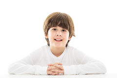 Boy sitting at table Royalty Free Stock Image