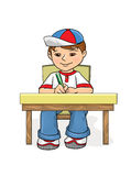 Examination Boy sitting at a table and wrote. Examination Little Boy sitting at a table and wrote in pencil in a notebook And Smiling, age of 5-8 years, in Stock Photos