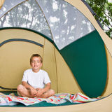 Boy sitting in tent Royalty Free Stock Photo