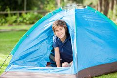 Boy Sitting In Tent Royalty Free Stock Photography