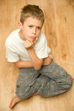 Boy sitting and thinking Stock Photos