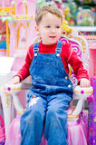 Boy sitting on throne Stock Photography
