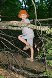 Boy sitting by a tree Royalty Free Stock Images