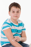 Boy sitting after vaccination Royalty Free Stock Image