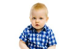 Boy sitting on a white background Royalty Free Stock Image