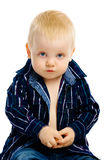Boy sitting on a white background Royalty Free Stock Images