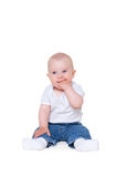 Boy sitting on the white floor Stock Photo