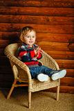 Boy sitting in wicker chair Royalty Free Stock Photo