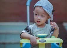 Boy Sitting on Yellow and Blue Trike Royalty Free Stock Images