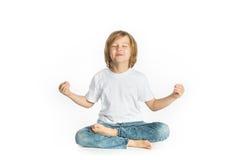 Boy sitting. Yoga. Lotus Position. Royalty Free Stock Image