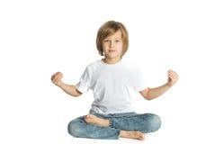 Boy sitting. Yoga. Lotus Position. Royalty Free Stock Photo