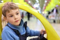 Boy sittingn in market wagon Royalty Free Stock Photo