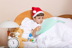 Boy of six years in the bed royalty free stock photo